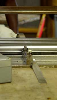 Feeding a metal strip into the flattening mill.